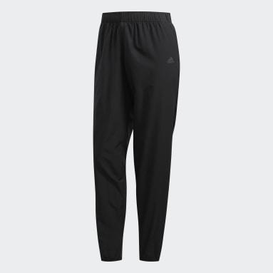 Pantalon Own the Run Astro Wind noir Femmes Course