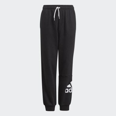 Chlapci Sportswear čierna Tepláky Essentials French Terry