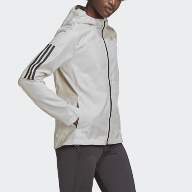 Giacca a vento Own the Run Hooded Beige Donna Running