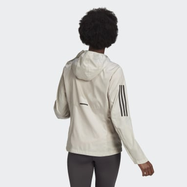 Women Running Beige Own the Run Hooded Wind Jacket