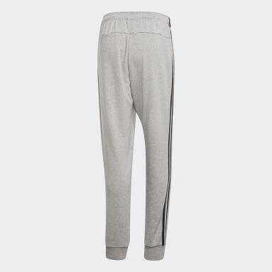 Pantalón Essentials Tapered Cuffed 3 bandas Gris Hombre Sportswear