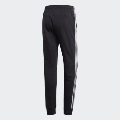 Muži Athletics čierna Tepláky Essentials 3-Stripes Tapered Cuffed
