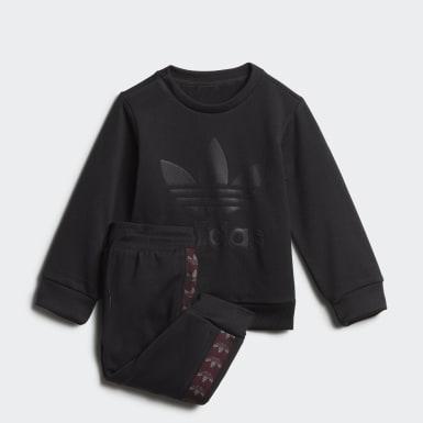 ชุดเสื้อคอกลมและกางเกง Debossed Trefoil