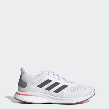 Women Running White Supernova Shoes
