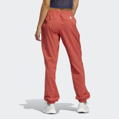 Pantaloni Woven Badge of Sport Rosso Donna Training