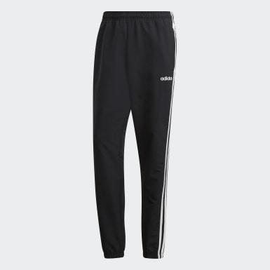 ผู้ชาย ไลฟ์สไตล์ สีดำ กางเกงกันลมขายาว Essentials 3-Stripes