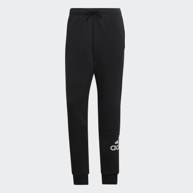 Pantalón Must Haves French Terry Badge of Sport Negro Hombre Sport Inspired