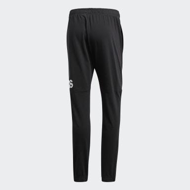 Muži Athletics černá Kalhoty Essentials Performance Logo