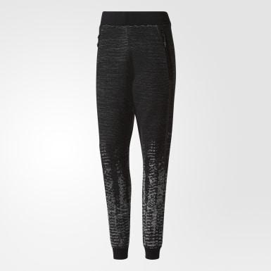 Ženy Athletics černá Kalhoty adidas Z.N.E. Pulse Knit