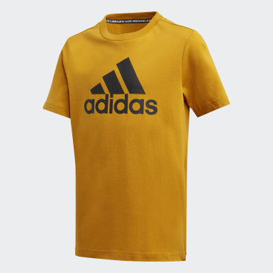 Camiseta  Badge of Sport Must Haves Oro Niño Training