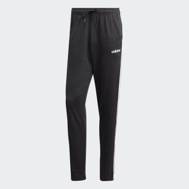 Muži Athletics čierna Tepláky Essentials 3-Stripes Tapered Open Hem