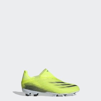 Kluci Fotbal žlutá Kopačky X Ghosted+ Laceless Firm Ground