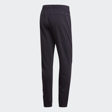 Pantalón Essentials Linear Tapered Negro Hombre Running