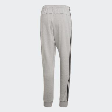 Calças Afuniladas 3-Stripes Essentials Cinzento Homem Athletics
