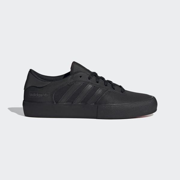 all black adidas skate shoes