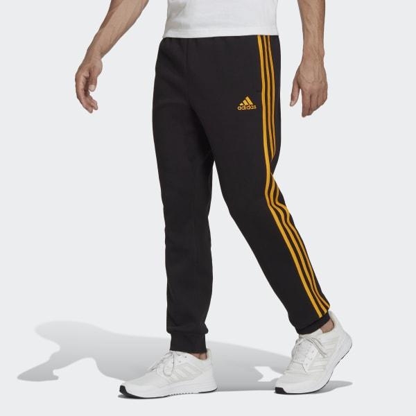 adidas Essentials Fleece Tapered Cuff 3-Stripes Pants - Black ...