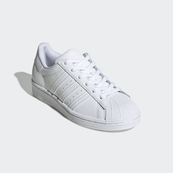 black adidas shoes with white stripes