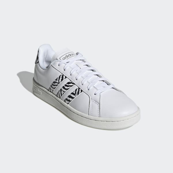 https://assets.adidas.com/images/w_600,f_auto,q_auto/70ba3eece7194ef39d84ad1300fd6479_9366/Chaussure_Grand_Court_Blanc_GZ0150.jpg