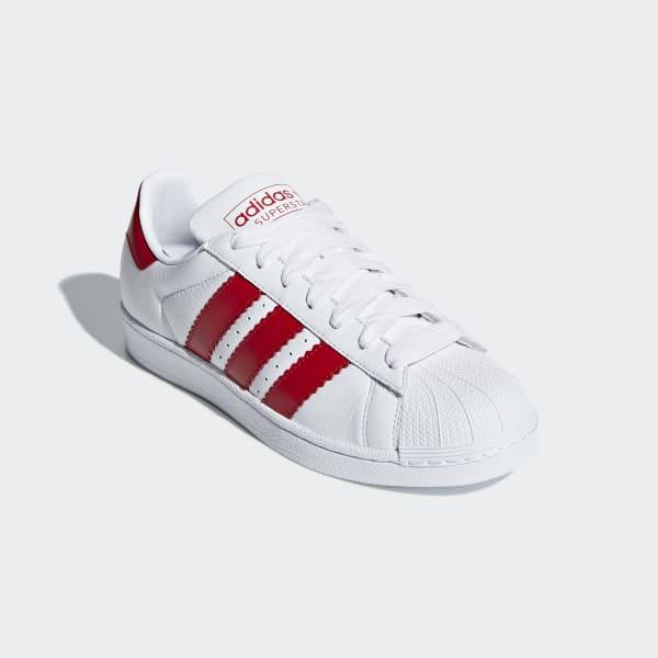 zijn adidas superstar brede schoenen