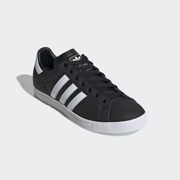 par svarte og hvite Adidas lav joggesko