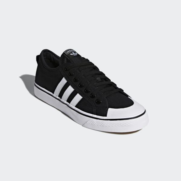 https://assets.adidas.com/images/w_600,f_auto,q_auto/8c3395d8769e4fc8b372a89700a8cd8f_9366/Chaussure_Nizza_Black_CQ2332.jpg