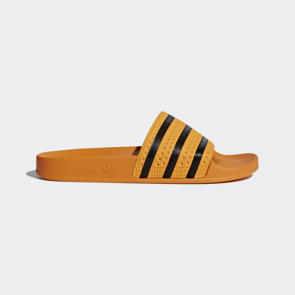 new york store retail prices adidas Adilette Slides - Gold | adidas US
