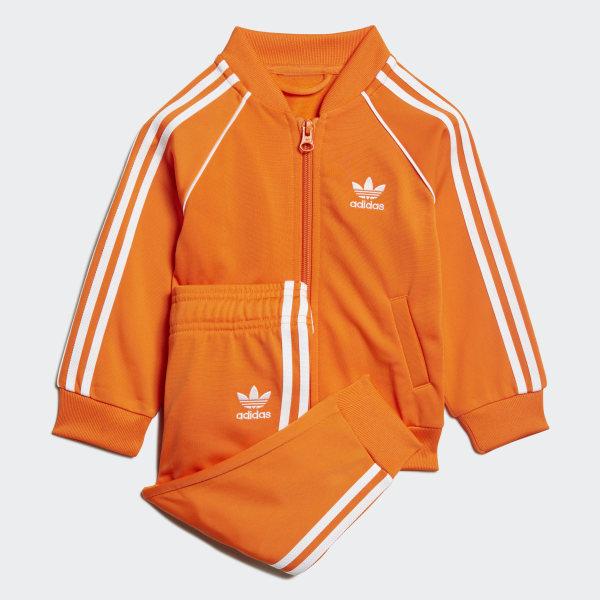 skate shoes quite nice big sale adidas SST Trainingsanzug - Orange | adidas Austria