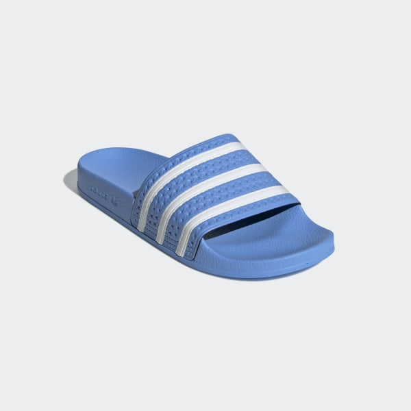 great fit outlet store authentic adidas Adilette Slides - Blue | adidas Ireland