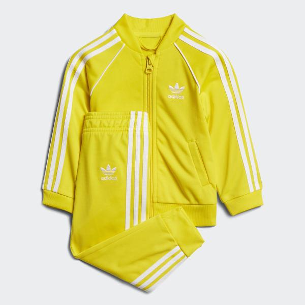 último vendedor caliente límpido a la vista diseño exquisito Conjunto Chaqueta y Pantalón SST - Amarillo adidas   adidas Chile