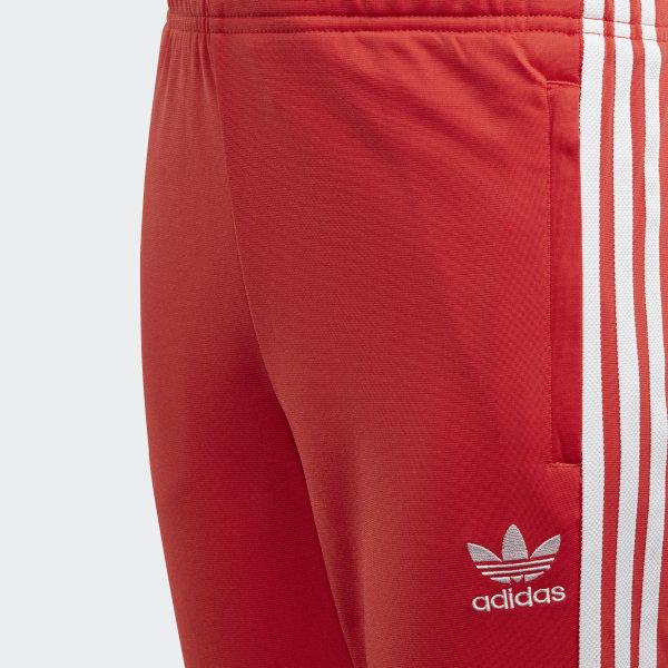 100% najwyższej jakości o rozsądnej cenie dobrze out x adidas Spodnie dresowe SST - Czerwony   adidas Poland
