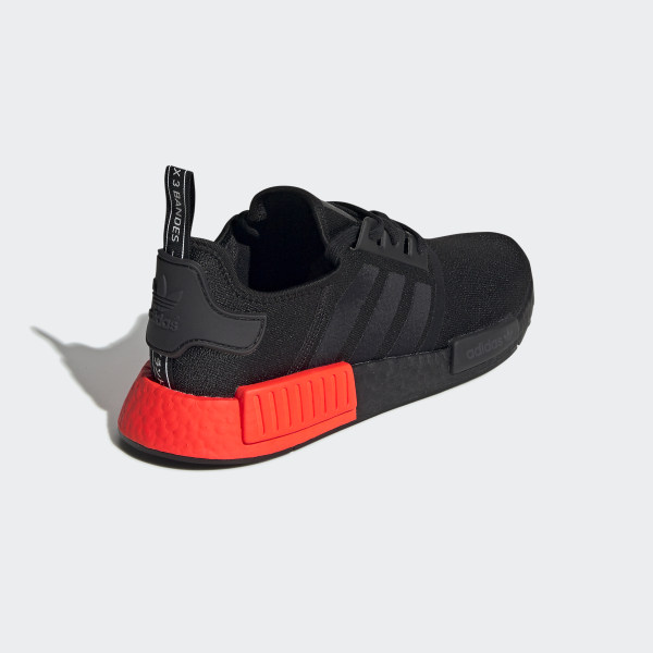black adidas shoes with red stripes