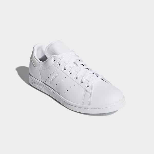 buy online 97136 2bc54 I m not into all white Adidas but I do like the text stamped into the  leather.