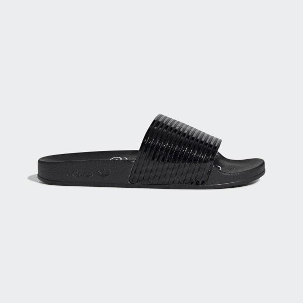 0e039fb6845 Adilette Slippers Core Black / Core Black / Ftwr White F33934