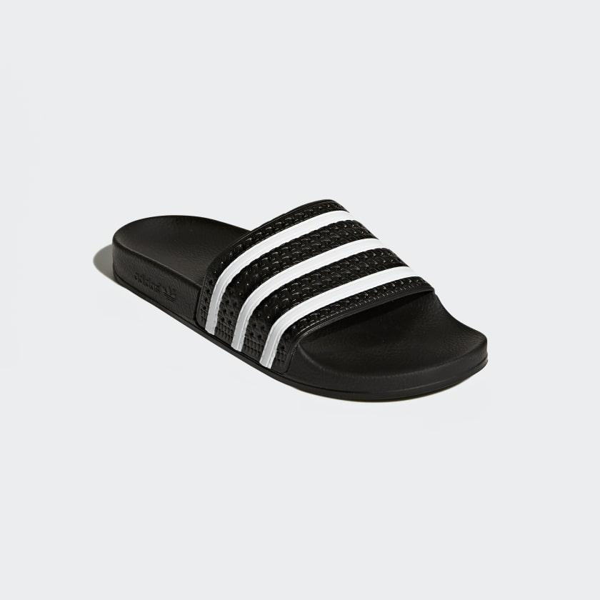 adidas Adilette Slides in . trQjlAcxm