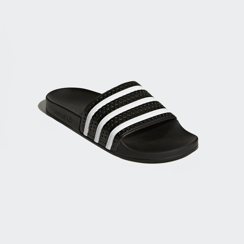 and it's been a style mainstay of adidas ever since  These men's slides  stay true to the authentic sporty look with a contoured footbed and  3Stripes